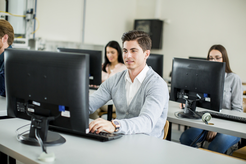 man-in-classroom-at-computer
